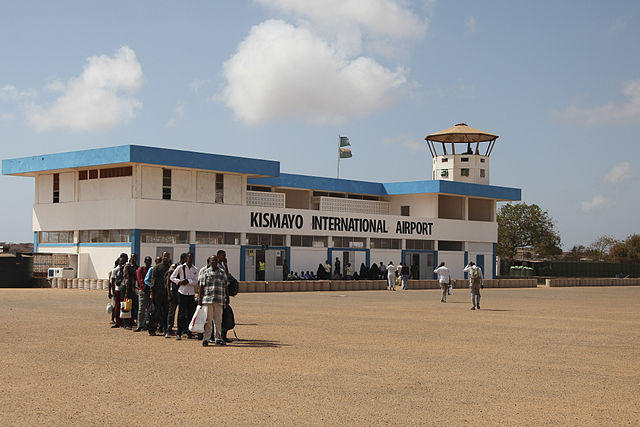 Passengers prepared to board an aircraft at Kismayo Airport